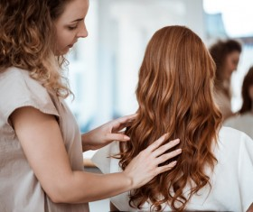 hairdresser who takes care of the hair for the customer Stock Photo 08