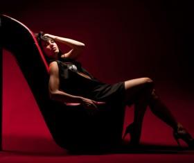 woman lying on a high heel chair Stock Photo