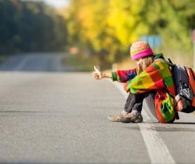 woman on a roadside free ride Stock Photo