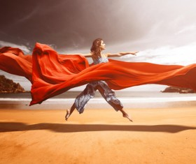 woman who dances red silk on the beach HD picture