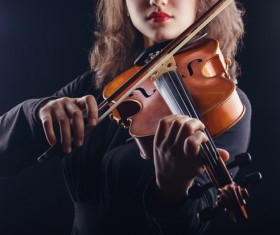woman who plays the violin Stock Photo