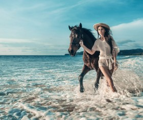 Beach woman walking horse HD picture