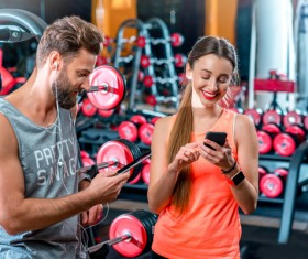Chatting men and women in the gym Stock Photo