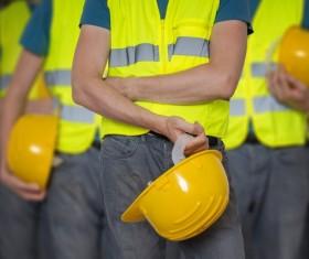 Construction worker holding a helmet