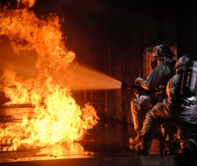 Firefighters fire fighting Stock Photo