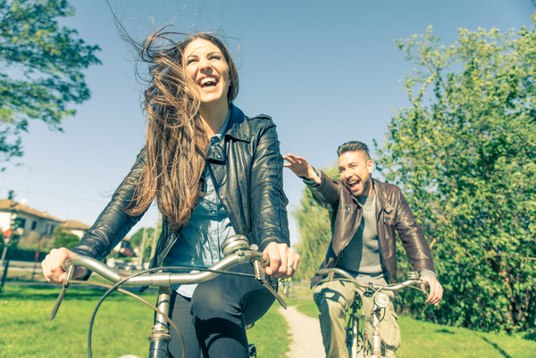 Happy couple riding a bike Stock Photo