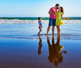 Happy family on the beach HD picture