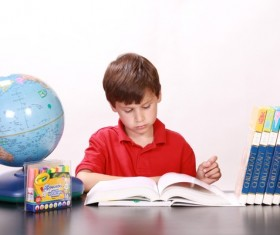 Learn to read the boy alone Stock Photo