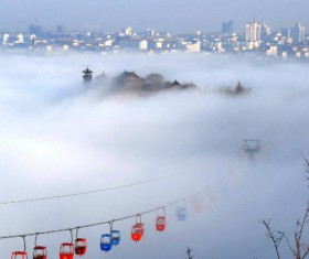 Mist-shrouded Penglai Pavilion and funicular Stock Photo
