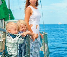 Mother with two children on a yacht Stock Photo