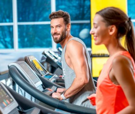 On a treadmill workout girl with coach Stock Photo 02