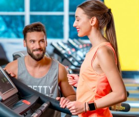 On a treadmill workout girl with coach Stock Photo 03