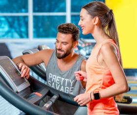 On a treadmill workout girl with coach Stock Photo 04