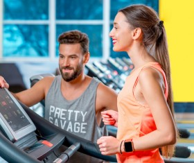 On a treadmill workout girl with coach Stock Photo 05