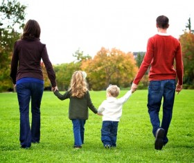 Parents walking in the park with their children Stock Photo