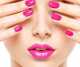 Pink nails and pink lipstick makeup girl Stock Photo