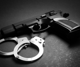 Pistols and handcuffs Stock Photo
