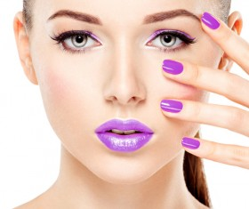 Purple nails with purple lipstick makeup girl Stock Photo