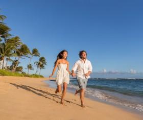 Seaside happy couple Stock Photo