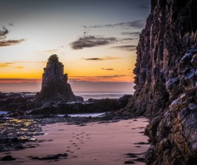 Seaside rocks at dusk HD picture