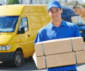 Smiling express courier Stock Photo