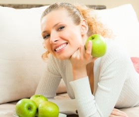 Smiling woman with green apple Stock Photo