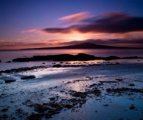Sunset Beach clouds Stock Photo