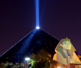 The modern pyramid of light technology and the Sphinx Stock Photo