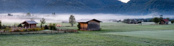 The wooden house on the plain Stock Photo