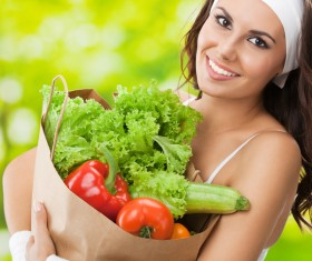 Woman buying vegetables Stock Photo