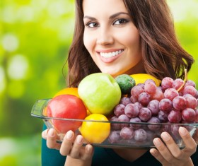 Woman carrying all kinds of fruit dish Stock Photo