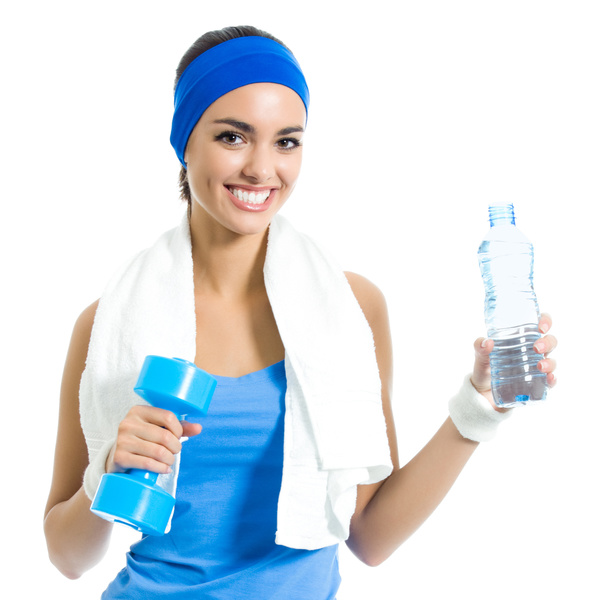 Woman holding a dumbbell and mineral water Stock Photo