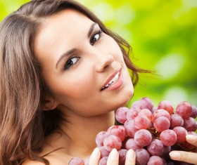 Woman holding grapes Stock Photo