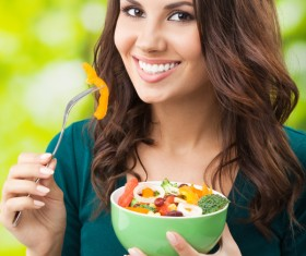 Woman holding vegetable salad Stock Photo