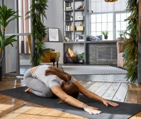 Woman practicing yoga in the living room Stock Photo 09