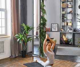 Woman practicing yoga in the living room Stock Photo 10