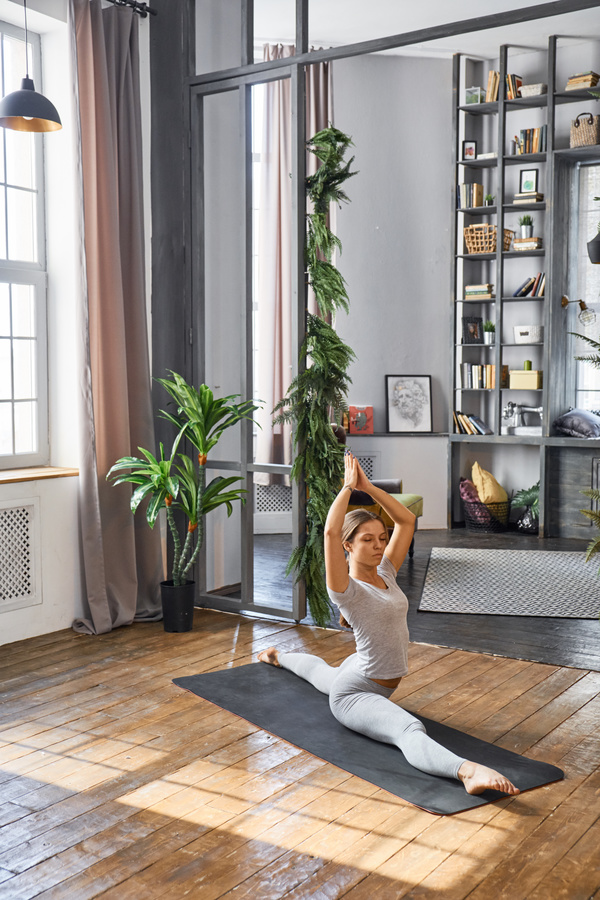 Woman practicing yoga in the living room stock photo 10 for Living room yoga