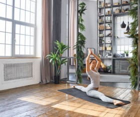 Woman practicing yoga in the living room Stock Photo 11