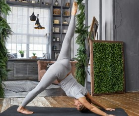 Woman practicing yoga in the living room Stock Photo 12