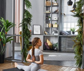 Woman practicing yoga in the living room Stock Photo 13