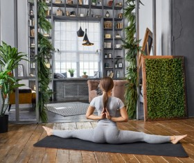 Woman practicing yoga in the living room Stock Photo 14