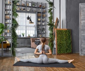 Woman practicing yoga in the living room Stock Photo 15