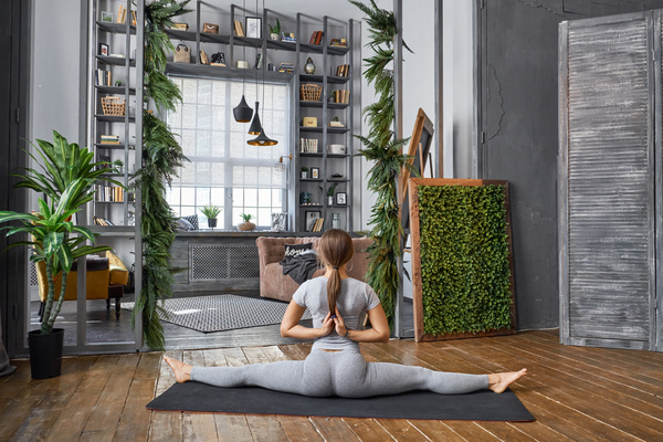 Woman practicing yoga in the living room stock photo 15 for Living room yoga