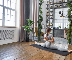 Woman practicing yoga in the living room Stock Photo 16