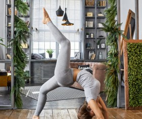 Woman practicing yoga in the living room Stock Photo 17