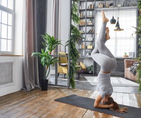 Woman practicing yoga in the living room Stock Photo 18