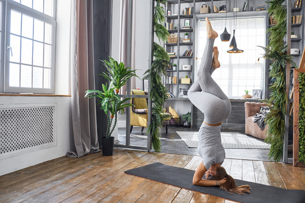 Woman Practicing Yoga In The Living Room Stock Photo 18 People Stock Photo