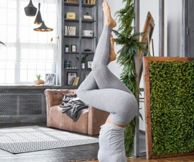 Woman practicing yoga in the living room Stock Photo 19
