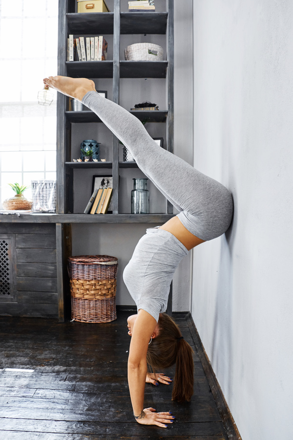 Woman practicing yoga in the living room stock photo 23 for Living room yoga