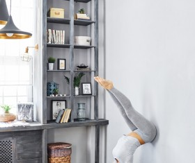 Woman practicing yoga in the living room Stock Photo 24